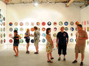Vinni Kiniki displays stencil art portraits on vinyl records in Detroit